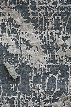 KPSI in a Finished Handknotted rug