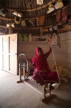 Rural women weaver spinning wool into yarn