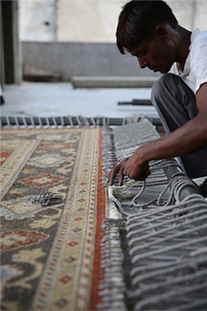 Handmade rug stretching and drying in the sun
